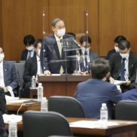 Prime Minister Yoshihide Suga speaks during a Lower House session Friday. | KYODO