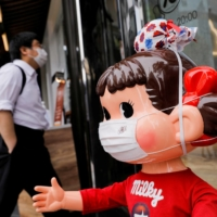 A mannequin is displayed outside a store in Tokyo on Thursday. | REUTERS