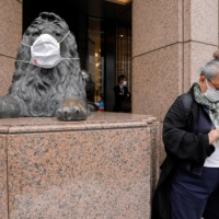 A masked statue outside a department store in Tokyo on Thursday | REUTERS