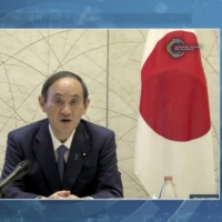 Prime Minister Yoshihide Suga speaks during the virtual Leaders Summit on Climate on Thursday. | WHITE HOUSE / VIA BLOOMBERG