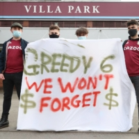 Fans display a banner reacting to the collapse of the European Super League prior to a match between Aston Villa and Manchester City at Villa Park in Birmingham, England, on Wednesday. | AFP-JIJI