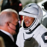 Japanese astronaut Akihiko Hoshide reacts as he arrives for the boarding of the SpaceX Falcon 9 rocket at Kennedy Space Center in Cape Canaveral, Florida, on Friday.  | REUTERS