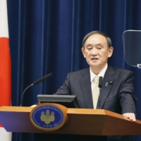 Prime Minister Yoshihide Suga speaks at a news conference in Tokyo on Friday. | KYODO