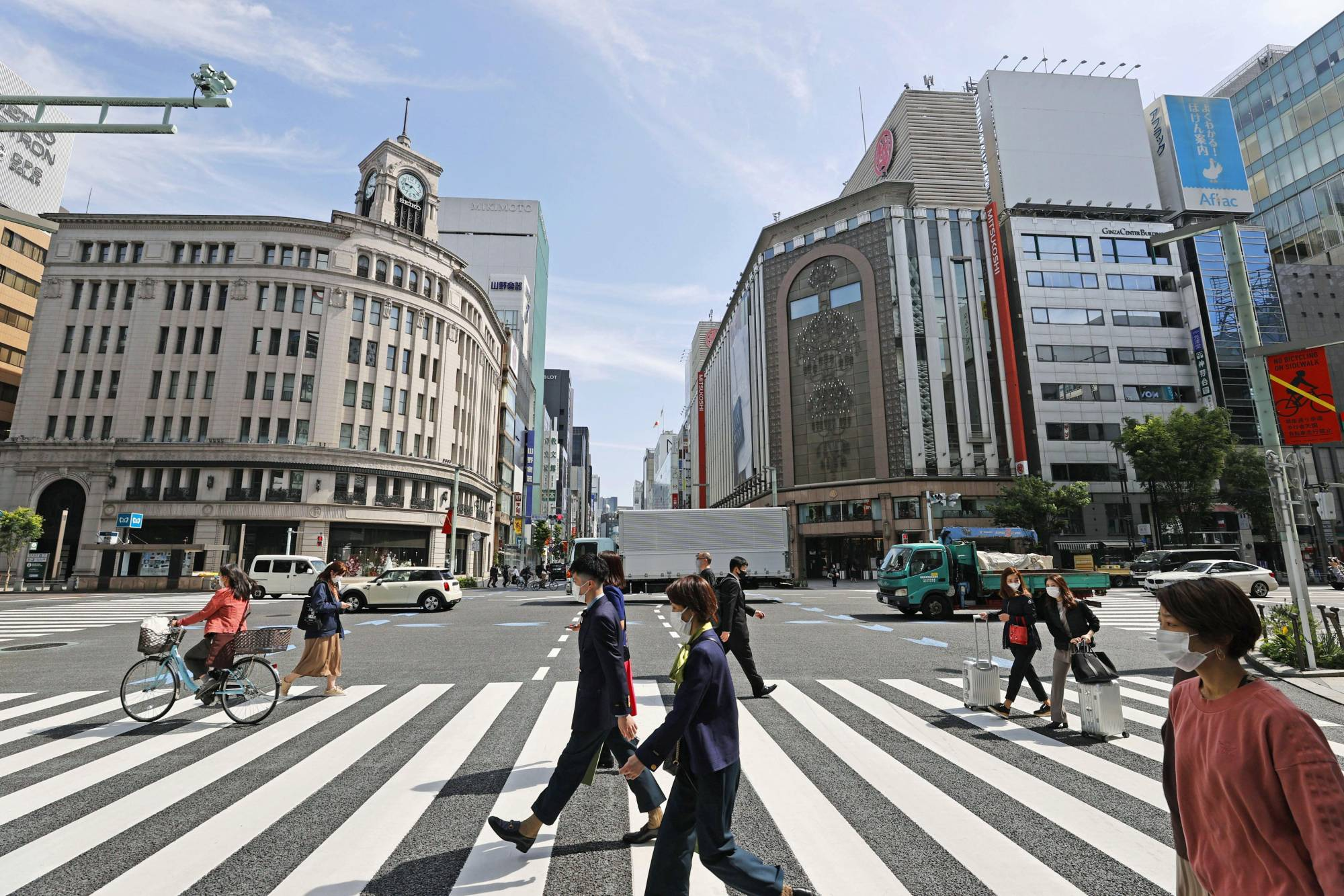 Pedestrians walk in Tokyo's upscale Ginza district on Saturday morning ahead of the new coronavirus state of emergency, which is due to go into effect on Sunday. | KYODO