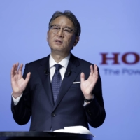 Toshihiro Mibe, president and chief executive officer of Honda Motor Co., speaks during a news conference in Tokyo on Friday. | BLOOMBERG