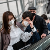 People visit a shopping mall in Tokyo on Saturday, a day before a new coronavirus state of emergency covering Tokyo, Osaka, Kyoto and Hyogo prefectures went into effect. | AFP-JIJI