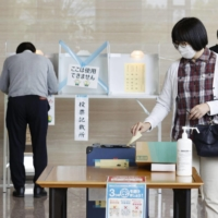 Voters cast their ballots for an Upper House by-election in the city of Nagano on Sunday. | KYODO