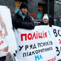 Anti-vaccination activists stage a protest outside presidential office in Kyiv in March.  | REUTERS