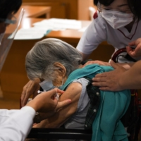 Japan is planning to set up large-scale vaccination venues that can handle about 10,000 people a day, the Nikkei business daily reported Sunday. | BLOOMBERG