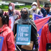 Demonstrators calling for democracy in Myanmar take part in a rally outside the Association of Southeast Asian Nations building in Jakarta on Saturday.  | AFP-JIJI