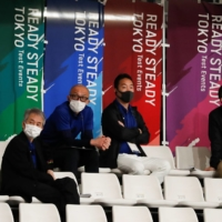 Officials wearing protective face masks watch the Tokyo 2020 track cycling test event at Izu Velodrome in Izu, Shizuoka Prefecture, on Sunday. | REUTERS