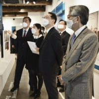 The Trilateral Cooperation Secretariat holds a photo exhibition in Seoul earlier this month to promote cooperation among Japan, South Korea and China. | KYODO