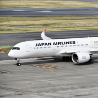 Japan Airlines Co. is planning to make a unit of Chinese low-cost carrier Spring Airlines Co. a subsidiary. | KYODO