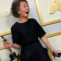 Youn Yuh-jung, winner of the best supporting actress Oscar for her role in 'Minari,' poses in the press room at Union Station in Los Angeles on Sunday.  | POOL / VIA AFP-JIJI