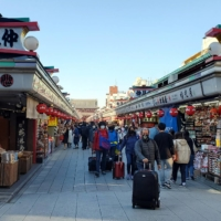 Tourists make their way through Tokyo's Asakusa neighborhood in March 2020.