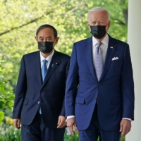 The 2021 edition of the Diplomatic Bluebook says the Japan-U.S. alliance continues to serve as the cornerstone of Japan's diplomatic and security policies. | AFP-JIJI