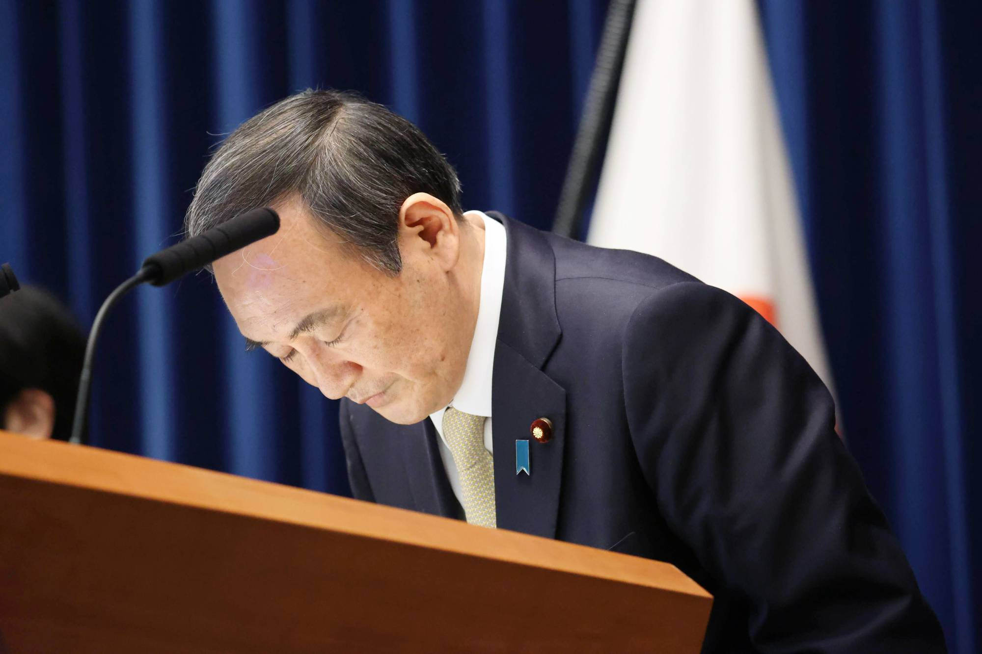 Prime Minister Yoshihide Suga apologizes for issuing the third coronavirus state of emergency during a news conference at the Prime Minister's Office on Friday. | POOL / VIA KYODO