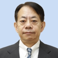 Masatsugu Asakawa took office in January last year to serve the remaining term of his predecessor. | KYODO