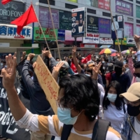 Protesters take part in a demonstration against the military coup in Tarmwe township, Yangon, Myanmar on Monday. | AFP-JIJI