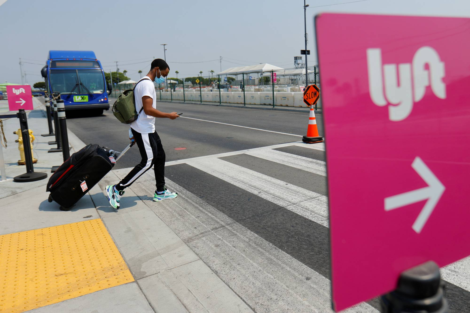 A sign for Lyft's ride-hailing service is displayed at Los Angeles International Airport.   REUTERS