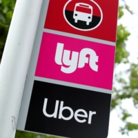 Signs for Lyft and Uber users are displayed at San Diego State University in California.   REUTERS