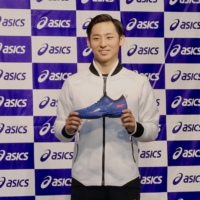 Yuki Kawamura poses for photos during a news conference earlier this month announcing his advisory contract with footwear-maker Asics. | KAZ NAGATSUKA