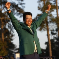 Hideki Matsuyama celebrates in the famous green jacket after winning the Masters on April 11 in Augusta, Georgia. | REUTERS