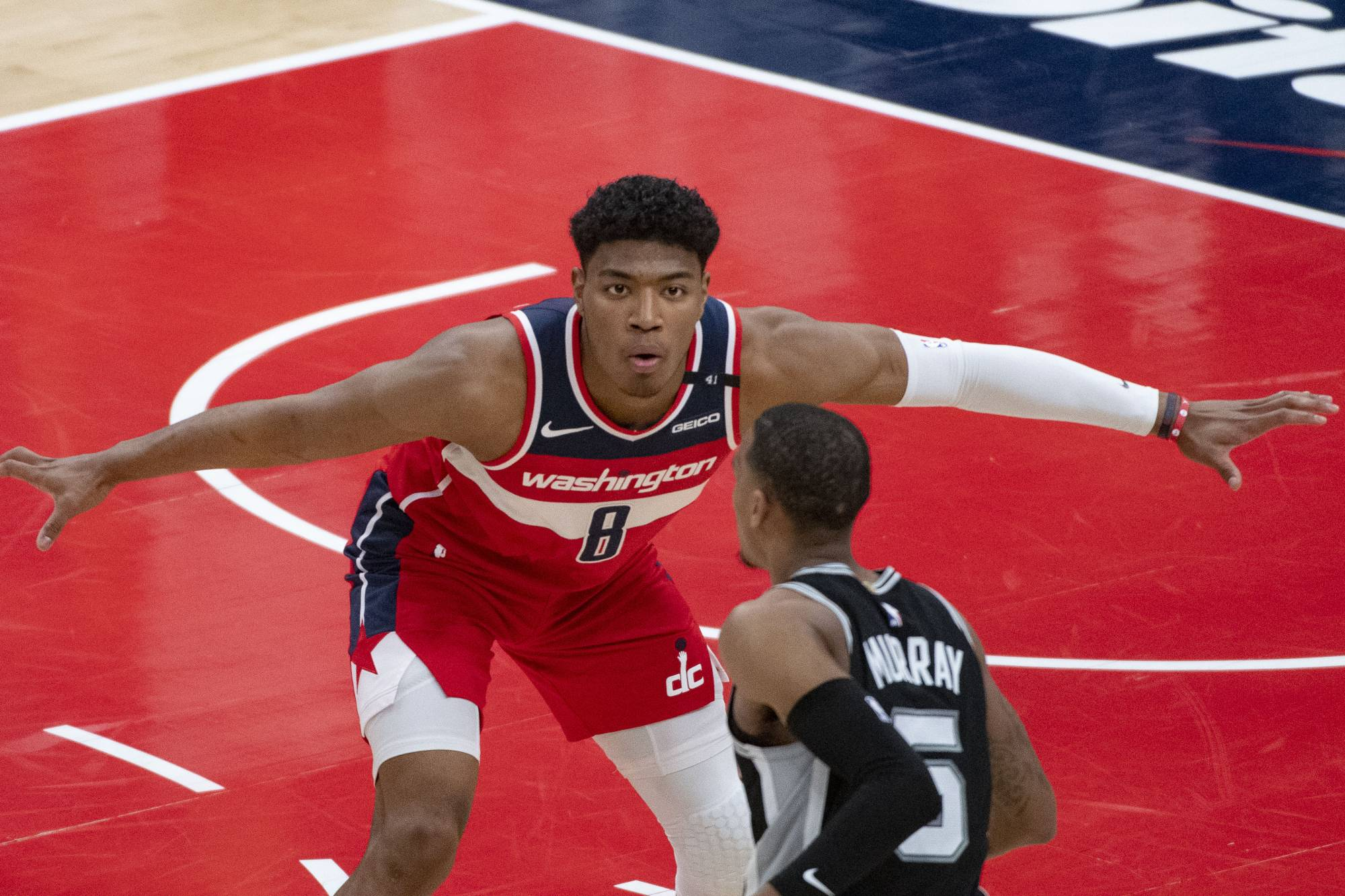 Wizards forward Rui Hachimura defends against Spurs guard Dejounte Murray on Monday at Capital One Arena in Washington. | USA TODAY / VIA REUTERS