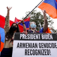 Members of the Armenian diaspora rally in front of the Turkish Embassy in Washington on Saturday after U.S. President Joe Biden recognized that the 1915 massacres of Armenians by the Ottoman Empire constituted genocide. | REUTERS