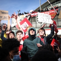 Arsenal fans protest against club owner Stan Kroenke on Friday in London. | REUTERS