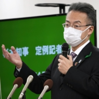 Fukui Governor Tatsuji Sugimoto addresses reporters in the Fukui Prefectural Government building on Wednesday after announcing approval to operate nuclear power plants beyond their 40-year limit.  |  KYODO
