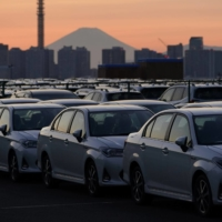 Toyota Motor Corp. vehicles bound for shipment at a port in Yokohama in October. Toyota's global sales surged 44.2% in March from a year ago to a record 982,912 units. | BLOOMBERG