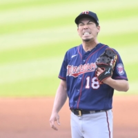 Twins starting pitcher Kenta Maeda reacts after giving up a home run in the first inning against the Indians on Tuesday in Cleveland. | USA TODAY / VIA REUTERS