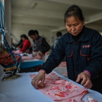 Guanyun's government says there are now more than 500 factories employing tens of thousands and churning out more than $300 million worth of lingerie annually. | AFP-JIJI