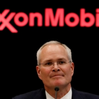 Darren Woods, chairman and CEO of Exxon Mobil, gives a news conference at the New York Stock Exchange in 2017. | REUTERS