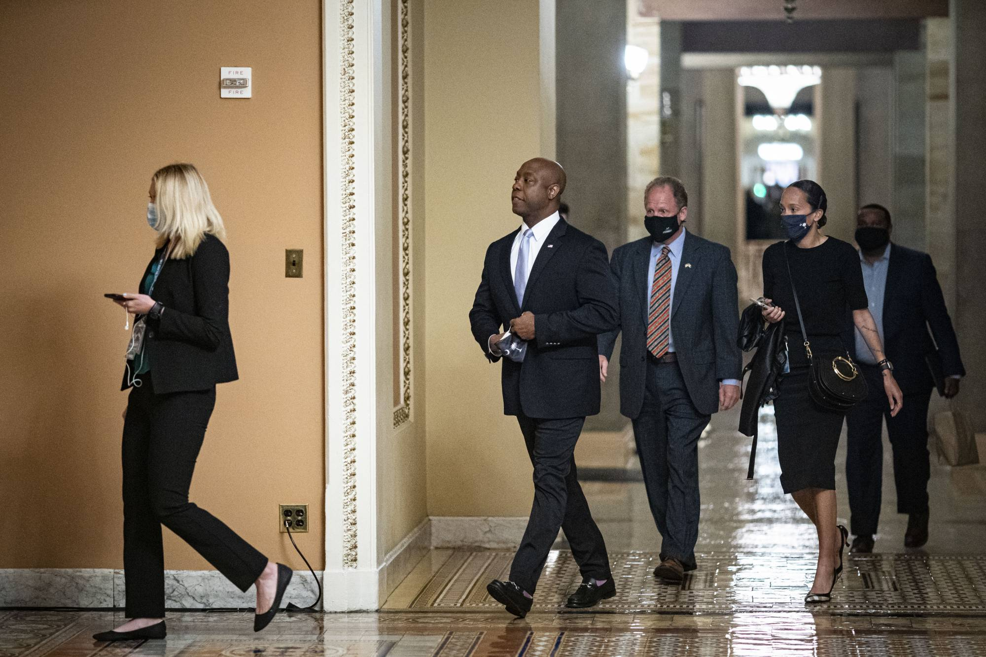 Senator Tim Scott, a Republican from South Carolina, center, arrives to deliver the GOP response to President Biden's address to Congress on Wednesday. | BLOOMBERG