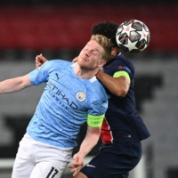 Manchester City's Kevin De Bruyne (front) and Paris Saint-Germain's Marquinhos vie for the ball during the first leg of their Champions League semifinal on Wednesday in Paris | AFP-JIJI