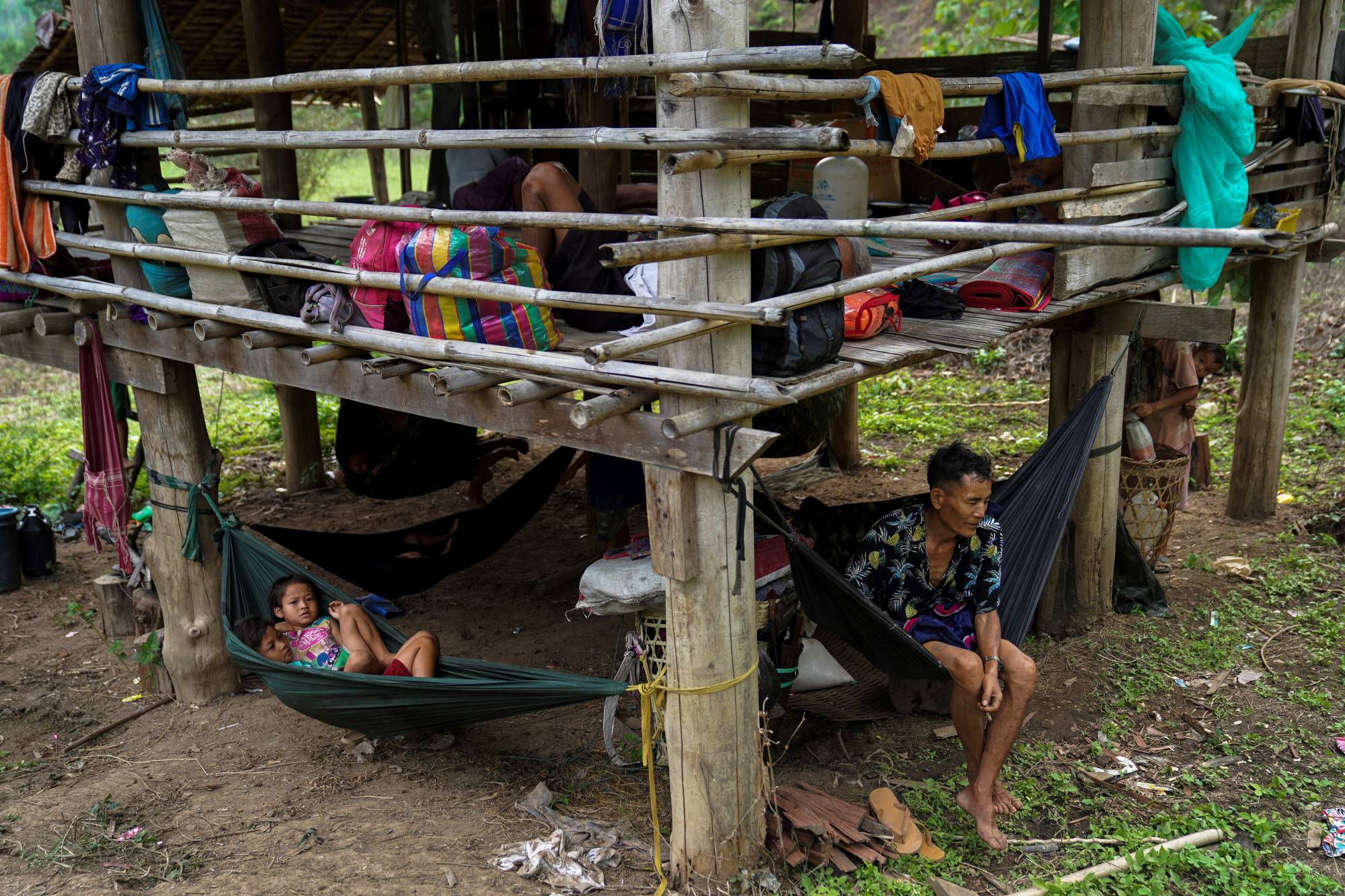 Villagers who fled Myanmar's Ee Thu Hta displacement camp rest in Mae Hong Son province, Thailand, on Thursday, after fleeing from gunfire between ethnic minority Karen insurgents and the Myanmar military. | REUTERS