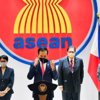 Indonesian President Joko Widodo speaks at a news conference after attending the ASEAN leaders' summit in Jakarta on April 24. | INDONESIAN PRESIDENTIAL PALACE / VIA REUTERS