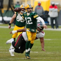 Packers quarterback Aaron Rodgers attempts a pass against the Buccaneers during the NFC title game at Lambeau Field in Green Bay, Wisconsin, on Jan. 24. | USA TODAY / VIA REUTERS