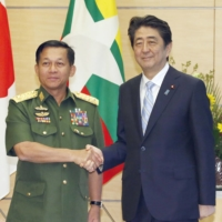 Then-Prime Minister Shinzo Abe met with Myanmar's military chief, Senior Gen. Min Aung Hlaing, at Abe's office in Tokyo on Aug. 4, 2017. | KYODO