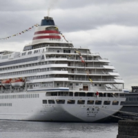 While infections are not believed to have spread among the 302 passengers and 425 crew aboard the Asuka II, the scheduled cruise was canceled and set to make an emergency return to port. | KYODO