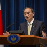 Prime Minister Yoshihide Suga speaks during a news conference in Tokyo on April 23. | GETTY IMAGES / VIA BLOOMBERG
