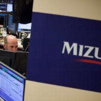 Mizuho Securities USA underpaid nonwhite employees based in part on performance reviews 'replete with thinly disguised racial stereotyping,' according to a lawsuit filed by four former executives. | BLOOMBERG