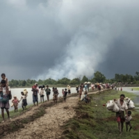 Rohingya refugees fleeing attacks from Myanmar's military cross into Bangladesh near Palong Khali in September 2017. The 2021 military coup in Myanmar has led many in the country' s Bamar ethnic majority to accept that democracy cannot flourish without respecting the minorities who have endured decades of military persecution.  | ADAM DEAN/THE NEW YORK TIMES