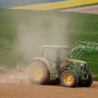 A French farmer driving a tractor on Friday raises a cloud of dust on his field in Gouzeaucourt as drought hits France.  | REUTERS