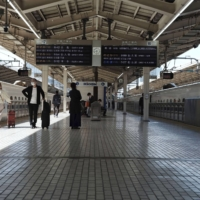 A handful of people are seen on the Tokaido Shinkansen platform at Tokyo Station on Saturday, the first day of a five-day weekend. | KYODO