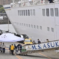 Japan cruise ship returns after passenger tests positive for COVID-19
