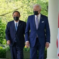 U.S. President Joe Biden and Prime Minister Yoshihide Suga head to a joint news conference at the White House in Washington on April 16. | AFP-JIJI