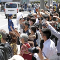 Six Tokyo Olympics torch relay staff members test positive for COVID-19